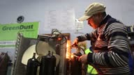An employee uses a welding torch while repairing an air conditioning unit at the refurbishment facility of GreenDust a unit of Reverse Logistics Co...