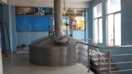 An employee walks past a brewing vat at the Murree Brewery Co factory in Rawalpindi Punjab Pakistan on Saturday May 13 2017 CU a brewing vat stands...