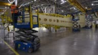 An employee works on a section of a wing on the Airbus A350 wing production line at the Airbus SE assembly factory in Broughton UK on Monday Jan 16...