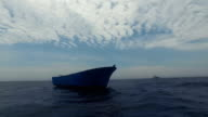 An empty migrant vessel drifts in the SAR zone on May 18 2017 off Lampedusa Italy Numbers of refugees and migrants attempting the dangerous central...
