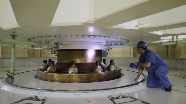 'WS An engineer inspects the upper bracket of a generator unit in Itaipu Binacional Dam / Foz do Iguacu, Brazil'