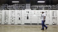 'WS An engineer walks past control units in Itaipu Binacional Dam / Foz do Iguacu, Brazil'