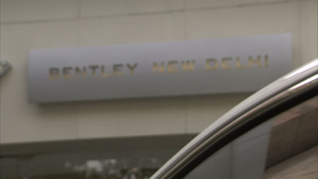 An engraved sign indicates Bentley New Delhi.