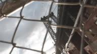 An establishing shot of Brooklyn's Williamsburg Bridge in industrial, Brooklyn.
