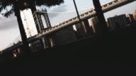 An establishing shot of New York City's Manhattan Bridge looming in the shadows.