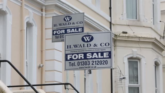 An estate agent sign advertising a property as ''For Sale' stands outside a residential building in Folkestone Kent An estate agent sign advertising...