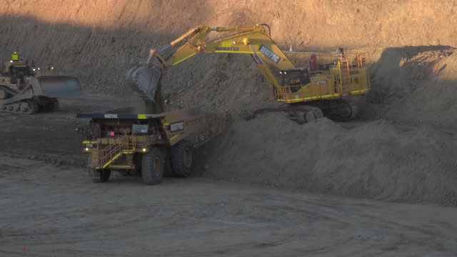 An excavator loads dirt onto a dump truck at Silver Lake Resources Ltd's Imperial/Magestic gold operations near Kalgoorlie Australia on Tuesday Aug 2...