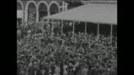 An excited crowd gather in front of the pavilion to cheer England's victory in the 5th Test match when they bowled Australia out for 125 in their...