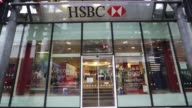 An HSBC sign sits outside a bank branch operated by HSBC Holdings Plc in London UK on Monday Feb 9 2015