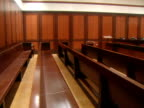 An immaculate courtroom occupies an area of the Queens County Criminal Courts Building in Queens New York