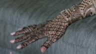 An Indian lady applying a henna tattoo
