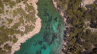 An inlet near Cassis harbour on the south coast of France with swimmers