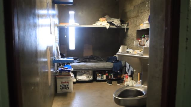 An inmate mops the floor at the Richard J Donovan Correctional Facility in San Diego California A view of an empty prison cell at the Richard J...