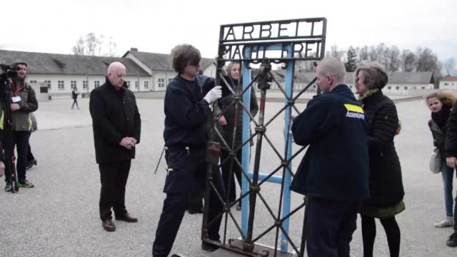 An iron gate with the infamous slogan Arbeit macht frei Work will set you free stolen from the former Nazi concentration camp of Dachau in Germany...