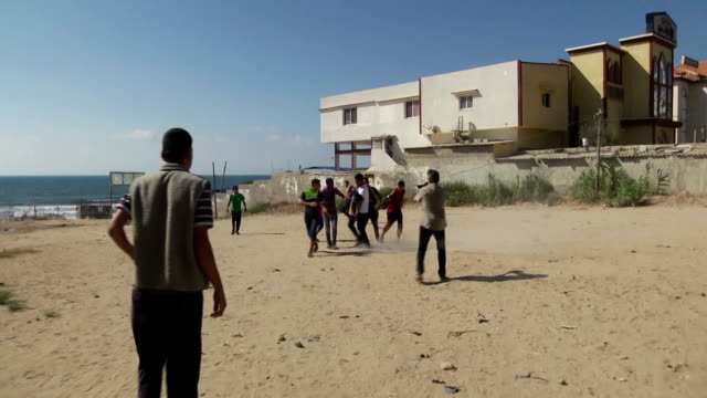 An Israeli airstrike kills 4 Palestinian children as they are playing on the beach on July 16 2014 in Gaza City Gaza Children are taken to the...