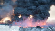An oil field that was set on fire by retreating ISIS fighters ahead of the Mosul offensive burns on October 21 2016 in Qayyarah Iraq Several hundred...