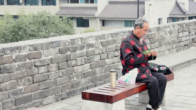 MS An old Chinese man knitting bag/xian,shaanxi,China
