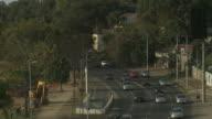 An oval window frames a view of heavy traffic in Porto Alegre, Brazil.