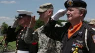 MS An unidentified US Marine US Army Private 1st Class Colin Morris and Vietnam Veteran Color Guard James Cloyes salute as participants of the annual...