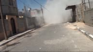 Anadolu Agency cameraman Hossam Keshta narrowly escapes an Israeli attack in Rafah city of Gaza on July 10 while he tries to shoot around a destroyed...
