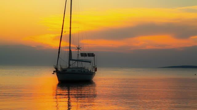 HD: Anchored Sailboat At Sunset