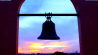 Ancient Bell against colorful sunset