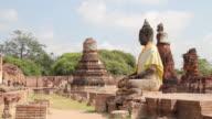 Ancient buddha statue and pagoda.