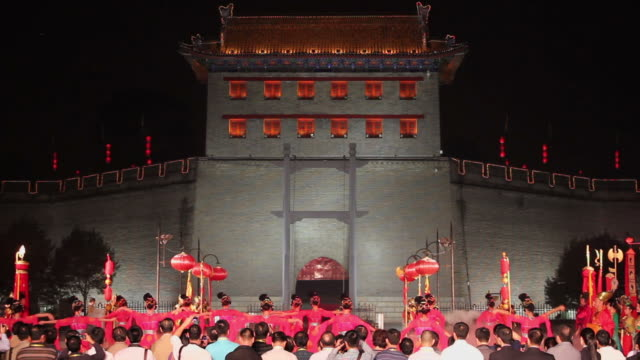 MS Ancient rituals to welcome the guests in front of city wall/xian,shaanxi,China