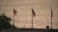 WS US and Puerto Rico flags waving at waterfront at dusk/ San Juan, Puerto Rico