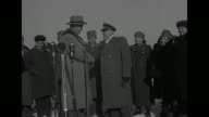US and Soviet Union flags flying on double flagpole / at Moscow airport US Secretary of State George Marshall shakes hands with Russian Deputy...