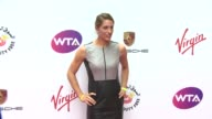 Andrea Petkovic at WTA PreWimbledon Party presented by Dubai Duty Free at Kensington Roof Gardens on June 19 2014 in London England