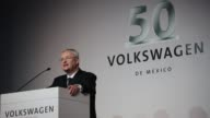 Andreas Hinrichs president of Volkswagen Mexico and Martin Winterkorn chief executive officer of Volkswagen AG speaks during a Volkswagen AG 50th...