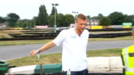 Andrew Flintoff promotes new Shell fuel at Sandown Park Various of Flintoff wearing tshirt with Shell oil logo / Shell Fuelsave Challenge car driven...