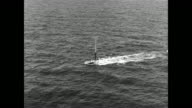 SS Andrew Jackson submarine begins to dive in the waters off of Cape Canaveral Florida / Polaris A3 missile breaks the water's surface and shoots...