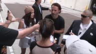 Andrew Lincoln Steven Yeun and Norman Reedus with fans at ComicCon in San Diego CA on 7/19/13