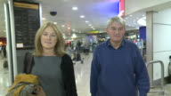 Andrew Mitchell MP and his wife Sharon arrive at Heathrow at the height of 'plebgate' scandal The former government whip is casually dressed as he...