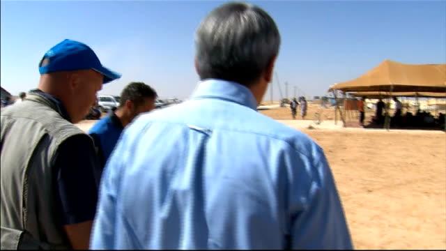 Andrew Mitchell visits refugee camp on Syrian border JORDAN Zaatri refugee camp EXT Andrew Mitchell MP along Mitchell along to meet Syrian man /...