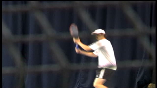 Doha INT Andy Murray warming up on indoor court