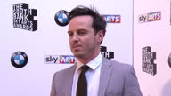 Andrew Scott posing for photos on red carpet Sky Arts Awards Honouring Best of Theatre Film Music and Art take place at the South Bank Centre in...