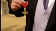 Andrew Strauss steps down as England captain LIB EXT Andrew Strauss posing with his OBE medal