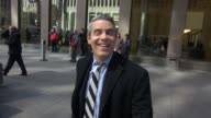 Andy Cohen leaving SiriusXM Satellite Radio signs for a fan on March 18 2015 in New York City