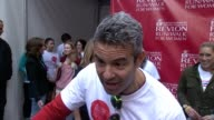 INTERVIEW Andy Cohen on how it's important for him to participate because he feels that this event is the result of people fighting the disease and...