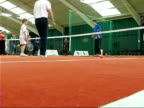 Andy Murray advises young players/ hit by ball Andrew Murray playing tennis with young boy