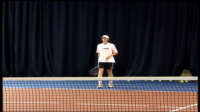 Andy Murray playing tennis on indoor court during training session QATAR Doha INT Andy Murray playing tennis on an indoor tennis court during...