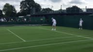 Andy Murray practises at Wimbledon on Friday morning despite a sore hip