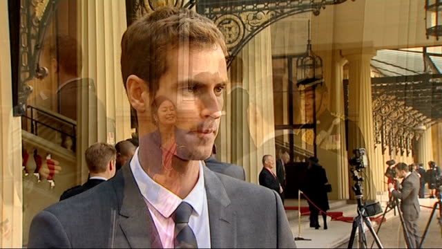 Andy Murray receives OBE from Prince William EXT Andy Murray posing with other recipients of honours outside Palace Andy Murray interview SOT watched...