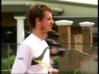 Andy Murray training with children / interview ENGLAND London Raynes Park EXT Various of Andy Murray gently hitting tennis ball in practice session...