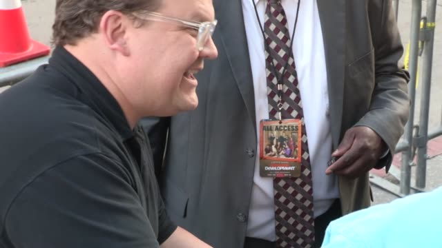 Andy Richter greets fans while arriving at the Arrested Development Season 4 Premiere in Hollywood 04/29/13