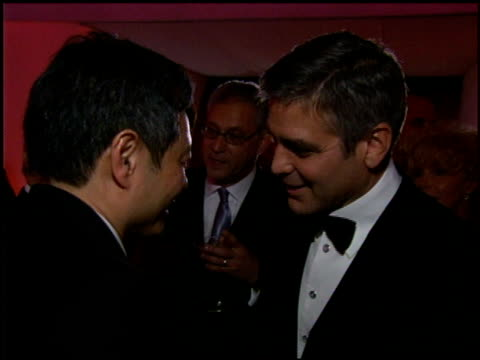 Ang Lee and George Clooney at the 2006 Academy Awards Governor's Ball at the Kodak Theatre in Hollywood California on March 5 2006