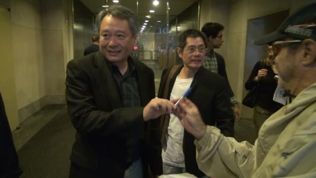 Ang Lee exits the Today show and while he signs for fans Suraj Sharma exits in New York 09/28/12